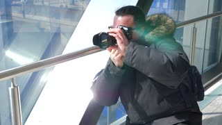 Photographer Taking A Photo In A Walkway Over Pass In Downtown 1