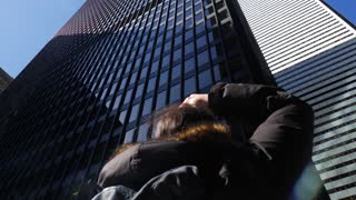 Photographer Taking Photo Of Tall Office Buildings Downtown 1