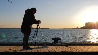 Photographer With Tripod And Dslr Taking Photos Of Sunset 1