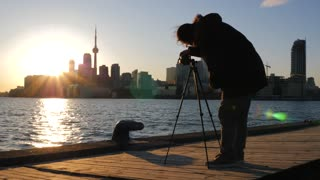 Photographer With Tripod And Dslr Taking Photos Of Toronto Cityscape Sunset 1
