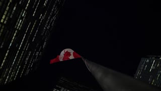 Rotating Around Tall Office Buildings Downtown With Tall Canadian Flag At Night 1