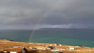 View Of Beautiful Full Rainbow As Storm Passes In Iceland 2