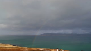 View Of Beautiful Full Rainbow As Storm Passes In Iceland 3