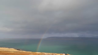 View Of Beautiful Full Rainbow As Storm Passes In Iceland 4