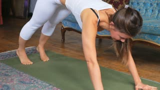 Young Attractive Female Doing A Downward Dog Stretch On A Yoga Mat 3