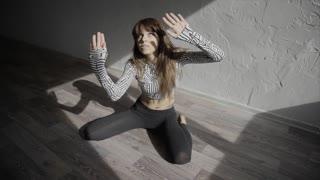 Beautiful, modern teenage girl dancer dancing contemp in the studio slow motion