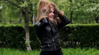 Beautiful teenage girl long blond hair moving dancing crazy emotions in park