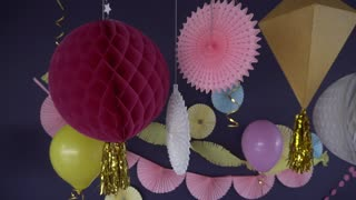 Birthday party decorations in purple and pink colors