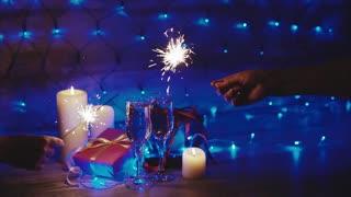 Burning sparklers on the background of Christmas decor celebration of Christmas