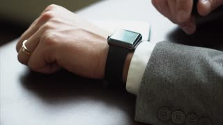 Business man using smart watches