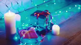 Close up of christmas and new year presents and candles with blue garland