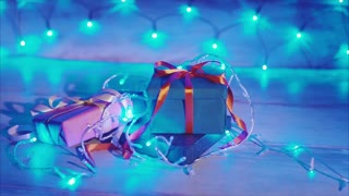 Close up of christmas gift boxes with blue garland