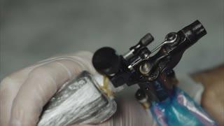 Close up of working tattoo machine