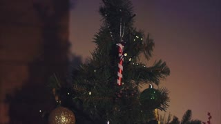 Close up shot of Christmas tree decorated with balls