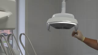 Dental lamp turns on by the sensor touching and light directly at the camera