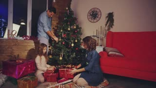 Family prepares gifts and decorate the Christmas tree