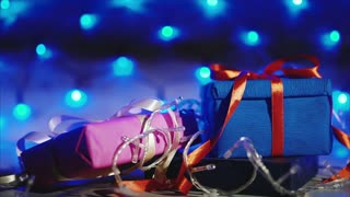Gift boxes with bright blue garland. Concept of christmas and new year