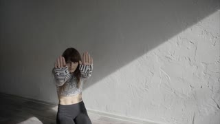 Graceful girl practicing contemp in studio, she performing the elements of dance