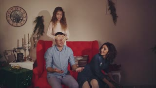 Happy family mother and daughter give a christmas gift to father concept of gift