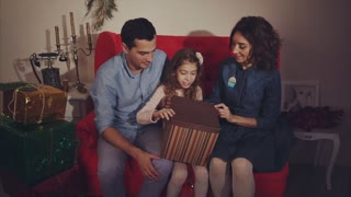Happy family open christmas present, parents shocked. Concept of gift.