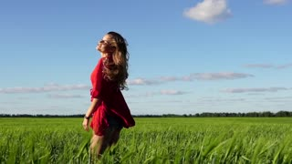 Happy woman enjoying nature beautiful blonde posing on field. Freedom concept.