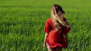 Happy woman enjoying nature blonde girl over sky and field. Freedom concept.