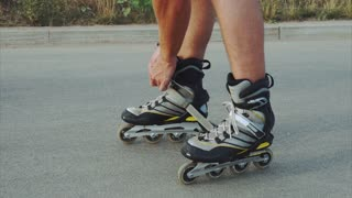 Man preparing for roller skating, putting on rollerskates