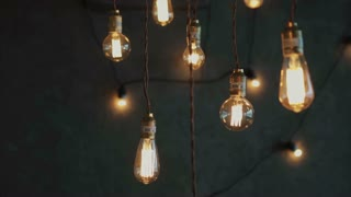 Old style glowing tungsten light bulbs, luxury lighting vintage decor