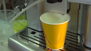 Process of making coffee by coffee machine pour coffee into the cup