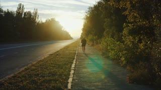 Senior gray haired man jogging on sunset city street