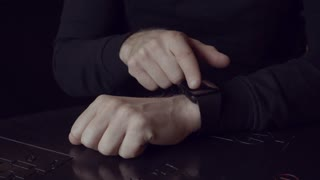 Shot of man hands using smart watch, smartwatch close up