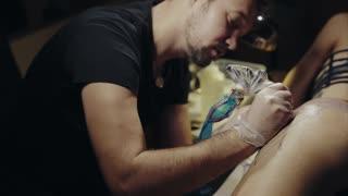 Tattoo artist make tattoo at the studio