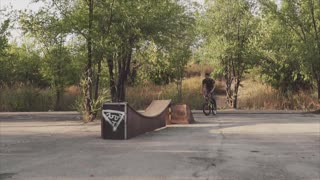 The rider by special bicycle BMX carries out tricks.