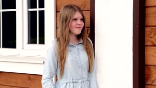 Video portrait of young happy smiling girl on the background of her home