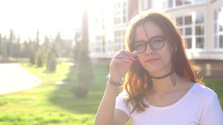 Video portrait teenage girl wearing glasses look at camera smile show braces