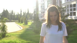Video portrait young beautiful teenage girl smiling walking on the city street