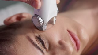 Close up facial LPG vacuum massage therapy. Woman getting facial rejuvenate therapy. Hardware cosmetology