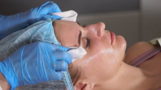 Close up of beauty skin care. Female's face, beautician removing facial peel. Peeling.