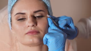 Close up of procedure of facial injection. Female patient and doctor with syringe of botox. Rejuvenate injection cosmetology