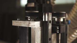 Close up shot of a working gears of a carving machine in process. Moving gears of a machine. Modern technology. High quaility.