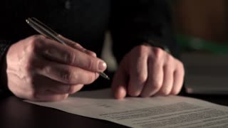 Close up shot of businessman hands who signs the document for transfer company.