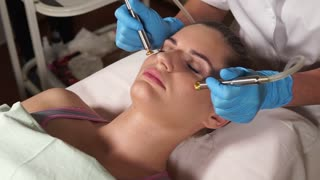 Close up shot of face skin care. Woman gets procedure in the beauty salon. Bio gas oxygen rejuvenation and lifting procedure.