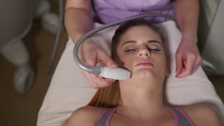 Close up shot of facial LPG vacuum massage therapy. Beautician perfoming rejuvenate procedure. Hardware cosmetology.