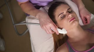 Close up shot of facial LPG vacuum massage therapy. Cosmetologist perfotming rejuvenate procedure. Hardware cosmetology.