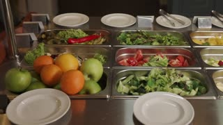 Close up shot of fresh furits and vegetables in metal food trays. Food for breakfast, lunch and dinner.