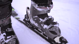 Close up shot of male legs with new alpine skiing equipment.