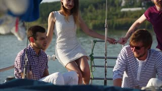 Group of people having a rest on the yacht. Relaxing water trip in the company of good friends