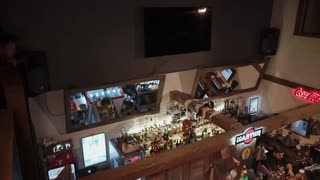 ROSA KHUTOR - FEBRUARY 2018: BAR Modern bar with big mirrors and tv made. Bartender talking and serving man and woman spending their date in the bar.