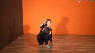 Slow motion shot of a girl in sportswear performing breakdance in the studio. She doing downrock and freezes. Street style dance