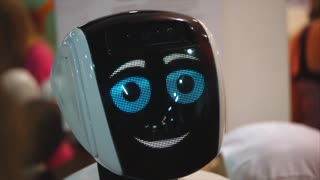 TOGLIATTI, RUSSIA - JULY 21, 2017: Big funny robot with big blue eyes smiling and talking. Antropomorf robot. Face screen friendly robot. In exhibition City of Robots in the Mall Park House.